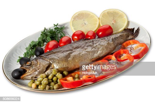 Baked trout with vegetables on the plate on a white background : Stock Photo