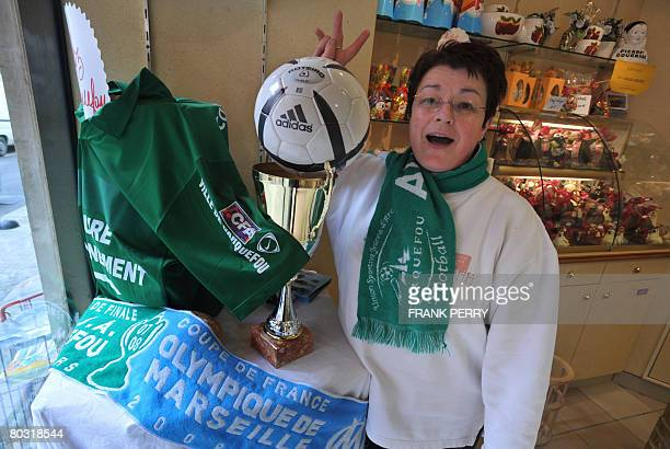 A baker and fan of amateur side football team of Carquefou makes the victory sign on March 20 2008 at her backery in Carquefou a suburb of Nantes...