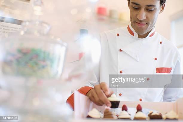 Baker Arranging Cupcakes