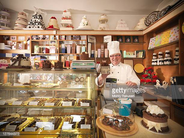 Baker at register in cake shop