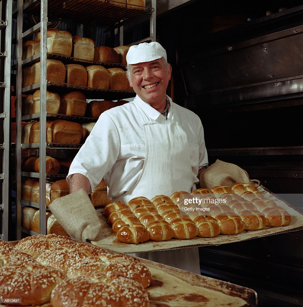 Baker carrying hot cross buns : Stock Photo
