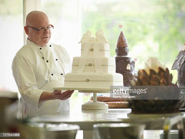 Baker checking decorative wedding cake