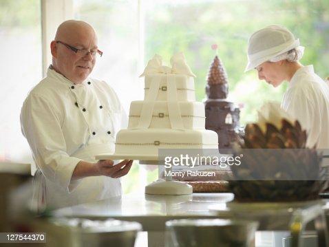 Baker checking decorative wedding cake