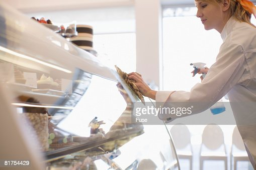 Baker Cleaning Window of Display Case