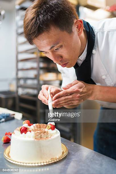 Baker decorating a cake