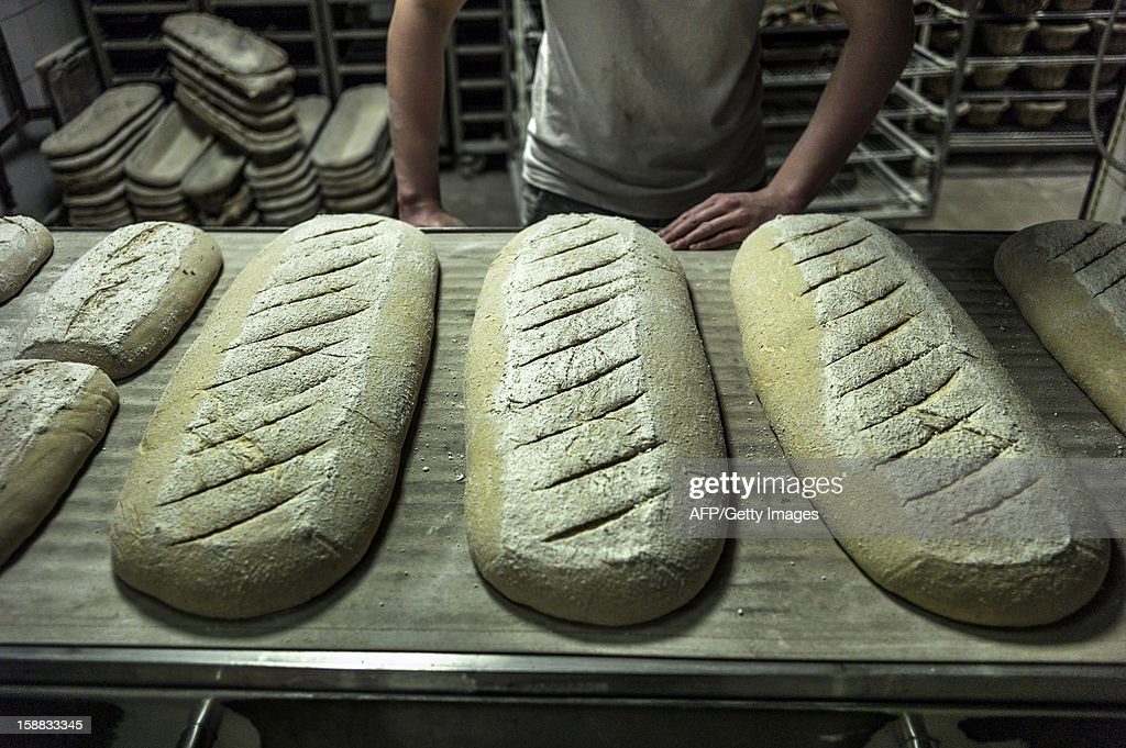 A baker is about to bake bread, on December 27, 2012 in a bakery of Ecole en Bauges, French Alps.