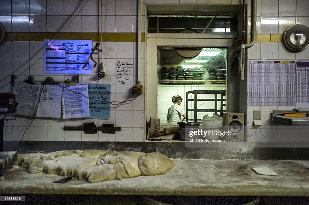 A baker is at work, on December 27, 2012 in a bakery of Ecole en Bauges, French Alps.