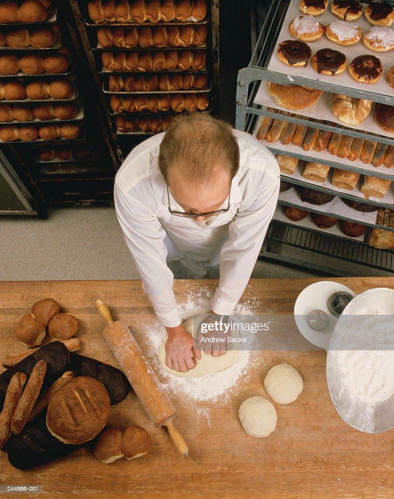 Baker kneading dough, overhead view : Stock Photo