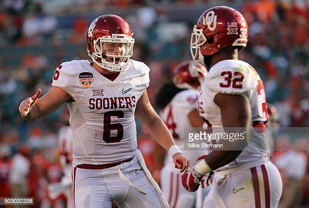 Baker Mayfield of the Oklahoma Sooners and Samaje Perine of the Oklahoma Sooners celebrate scoring a touchdown during the first quarter against the...