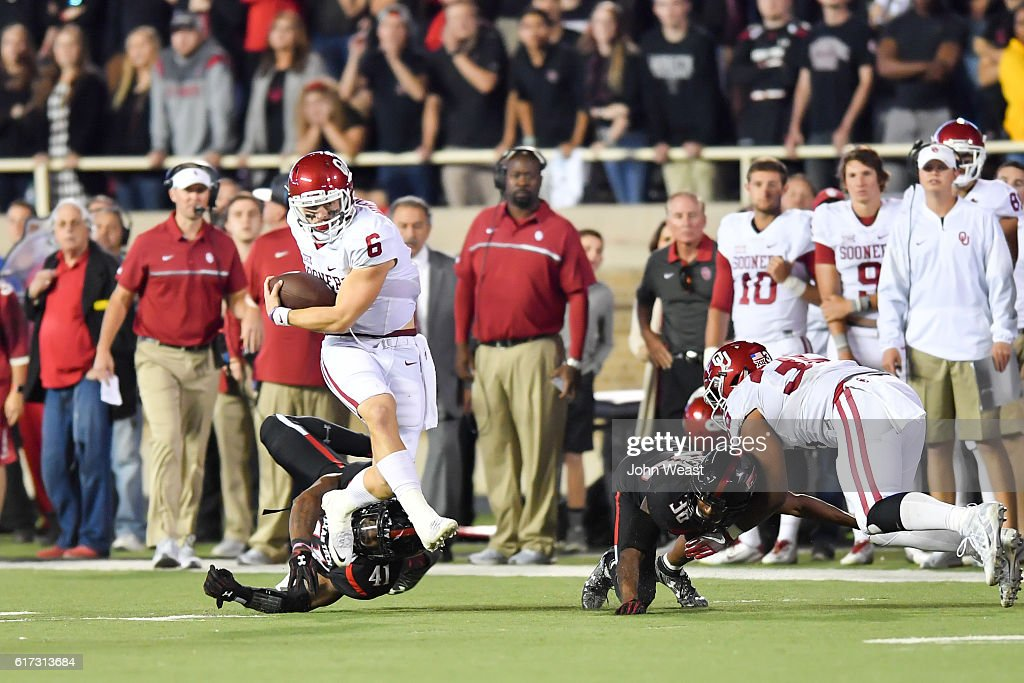Baker Mayfield #6 of the Oklahoma Sooners breaks the tackle of Malik Jenkins #41 of the Texas Tech Red Raiders during the game on October 22, 2016 at AT&T Jones Stadium in Lubbock, Texas. Oklahoma won the game 66-59.