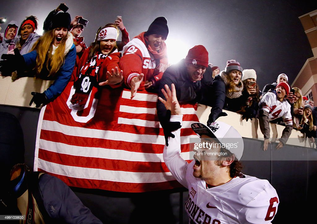 Baker Mayfield of the Oklahoma Sooners celebrates with fans after beating the Oklahoma State Cowboys 5823 at Boone Pickens Stadium on November 28...