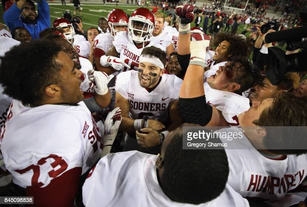 Baker Mayfield of the Oklahoma Sooners celebrates with teammates after defeating the Ohio State Buckeyes 3116 at Ohio Stadium on September 9 2017 in...