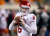 Baker Mayfield of the Oklahoma Sooners prepares to take on the Oklahoma State Cowboys at Boone Pickens Stadium on November 28 2015 in Stillwater...