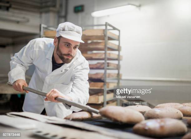 Baker on bread production line
