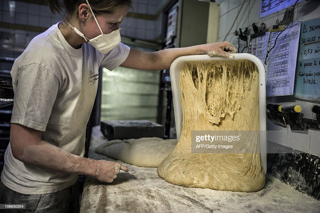 A baker prepares bread on December 27, 2012 in 'La Boulangerie Savoyarde' in Ecole-en-Bauges, French Alps.