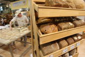 A baker prepares organic bread at a stand at the Gruene Woche agricultural trade fair January 18 2008 in Berlin Germany German demand for organic...