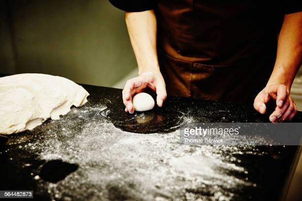 Baker preparing dough for pastry in kitchen