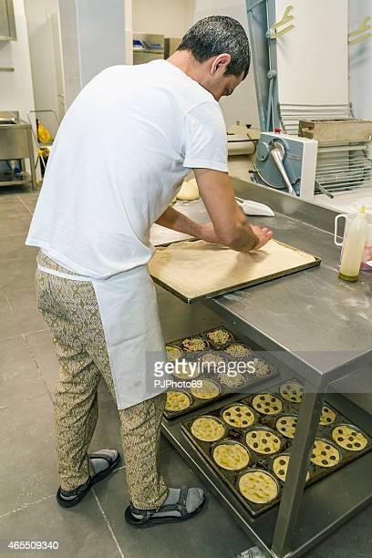Baker preparing focaccia