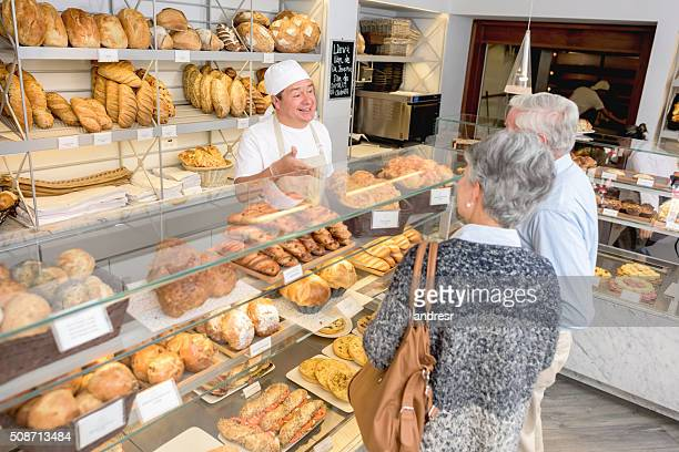 Baker serving customers at the bakery