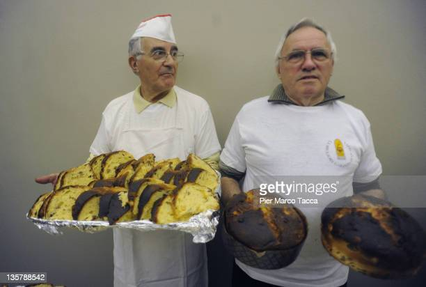 A baker shows Panettone typical Italian Christmas cake during a Christmas party at Milan on December 14 2011 in Milan Italy