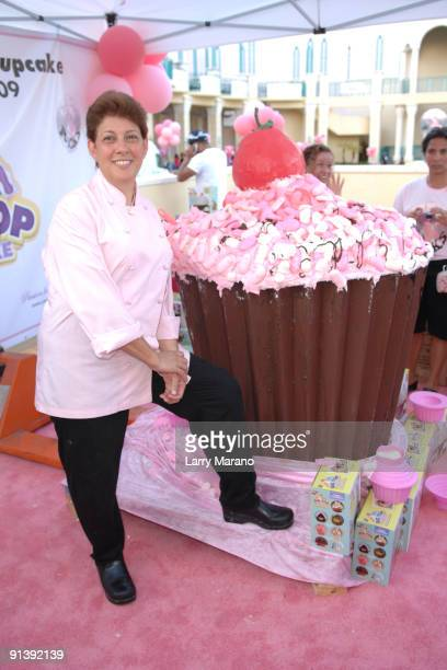 Baker Teri Cahn poses with the Guinness book of world records worlds largest cupcake at the Think Pink Rocks Concert to benefit breast cancer...