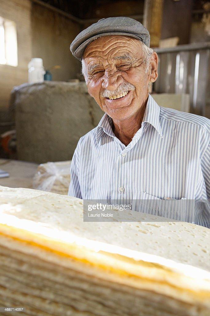 Baker with bread, Bazargan, Maku County