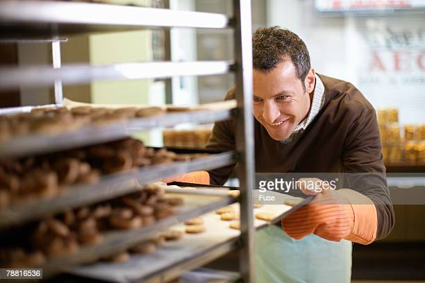Baker With Fresh Batch of Cookies