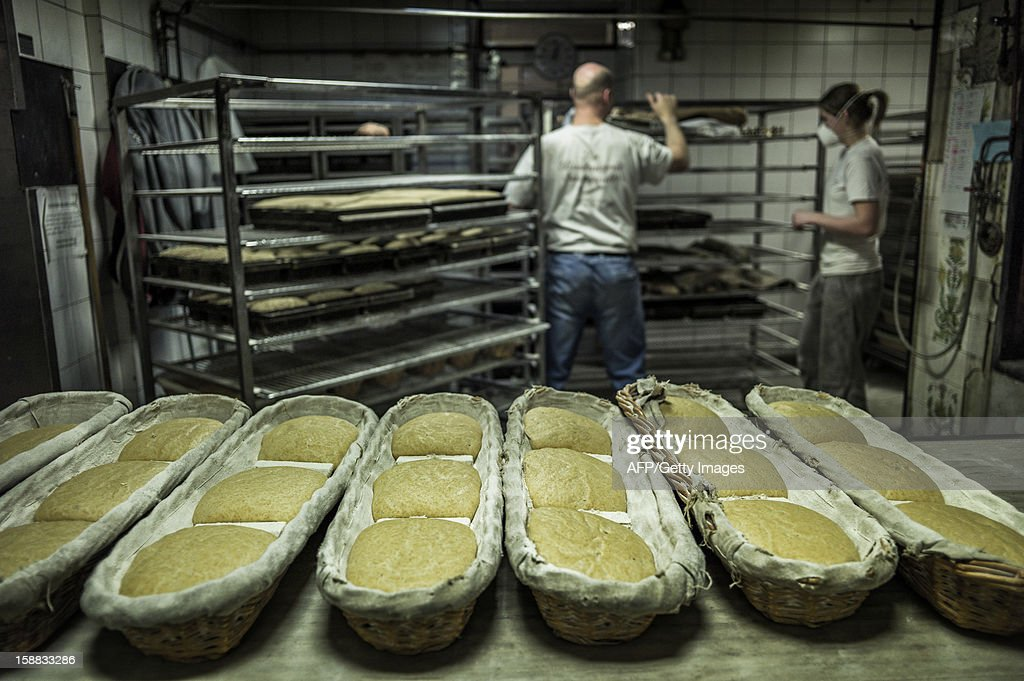 Bakers get ready to bake breads, on December 27, 2012 in a bakery of Ecole en Bauges, French Alps.