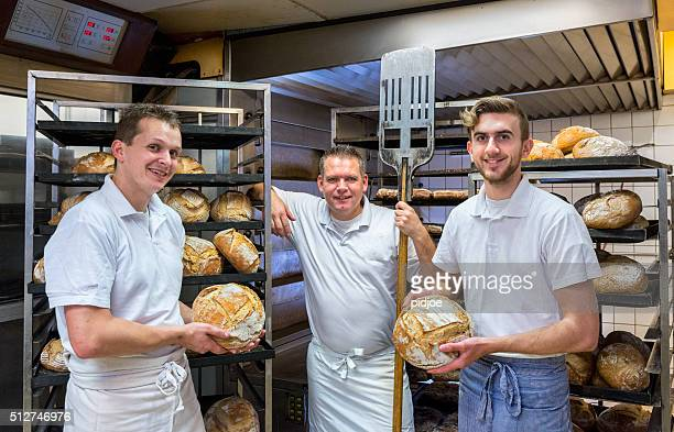 Bakers in their bakery, baking bread