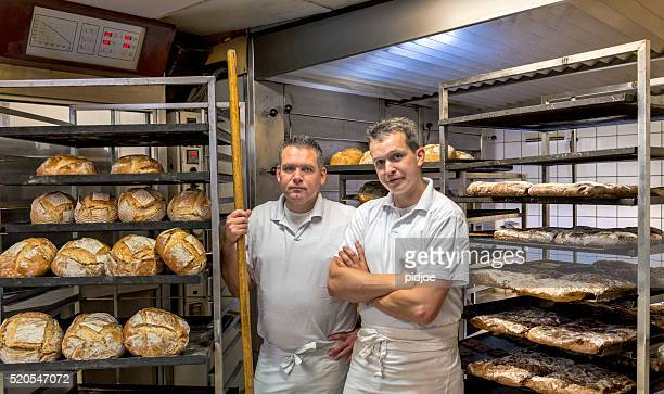 Bakers in their bakery, baking bread