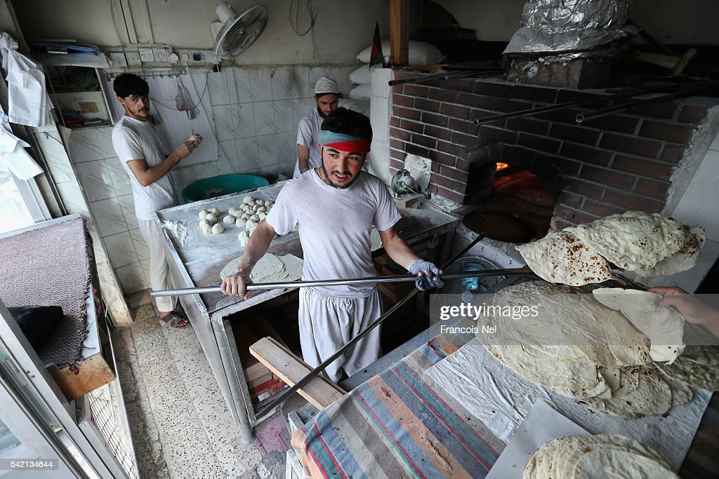 Bakers prepare bread during the holy month of Ramadan on June 22 2016 in Dubai United Arab Emirates Muslim men and women across the world observe...