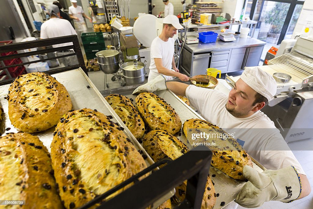Bakers prepare Original Dresden Christmas Stollen at the Wippler bakery on November 16, 2012 in Dresden, Germany. Stollen loaves come in several forms, including with raisins or almonds, and are among the traditional German Christmas foods. Dresden is home to a long Stollen tradition and bakeries must qualify for a 'Golden Seal' in order to call their Stollen 'Dresden Stollen'.