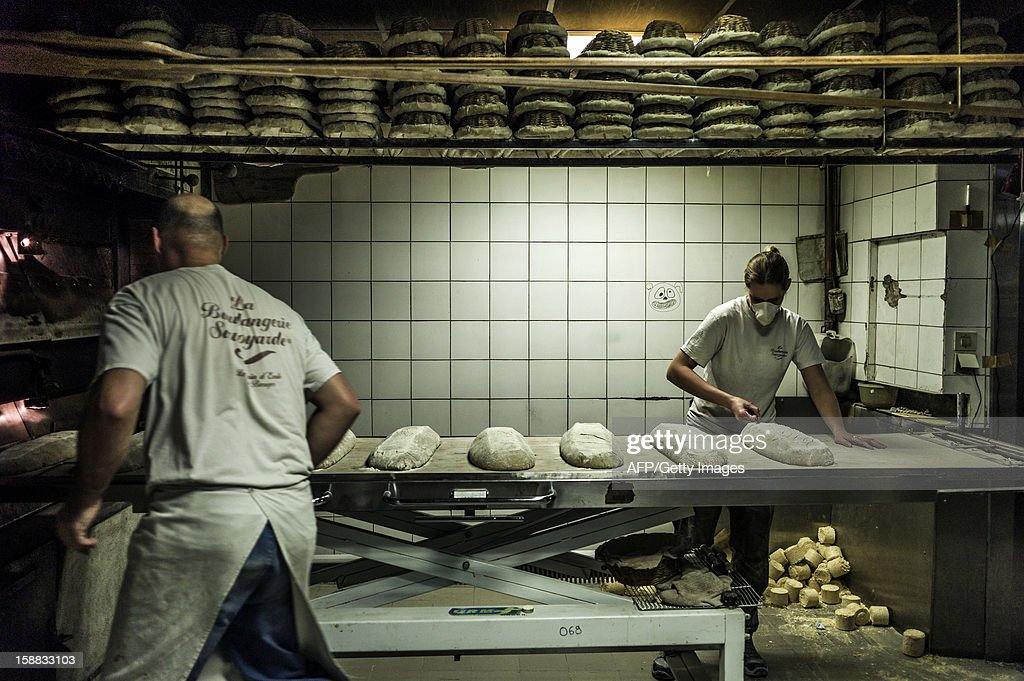 Bakers prepare to bake bread, on December 27, 2012 in 'La Boulangerie Savoyarde', a bakery in Ecole-en-Bauges, French Alps.