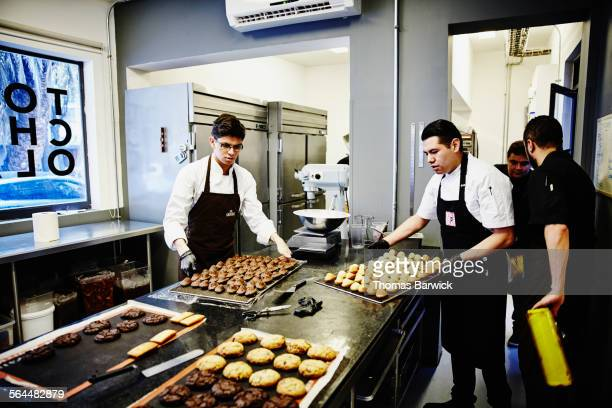Bakers preparing a selection of baked goods