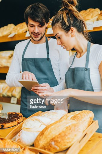 Bakers using a tablet : Stock Photo