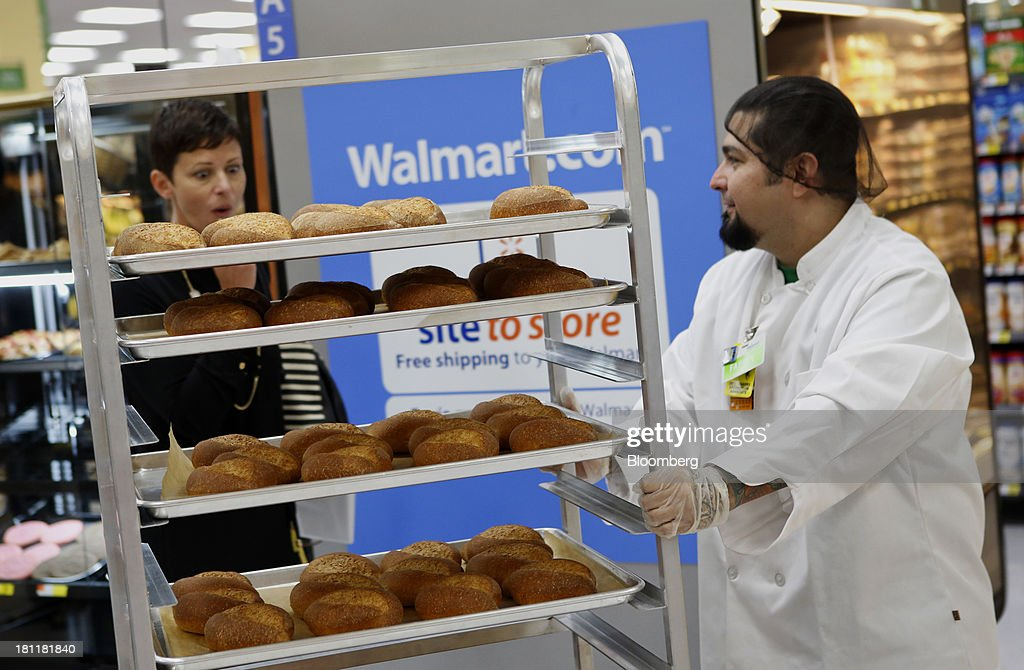 A bakery employee pushes a cart of fresh baked rolls during the grand opening of a Wal-Mart Stores Inc. location in the Chinatown neighborhood of Los Angeles, California, U.S., on Thursday, Sept. 19, 2013. Wal-Mart Stores Inc. will phase out 10 chemicals it sells in favor of safer alternatives and disclose the chemicals contained in four product categories, the company announced Sept. 12. Photographer: Patrick T. Fallon/Bloomberg via Getty Images