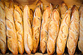 Stack of baguettes and breads in French bakery in Rhone Alpes, natural light, image taken with Nikon D800 and 24-70 lens, in RAW file format, XXXL size, developed with special attention on details.