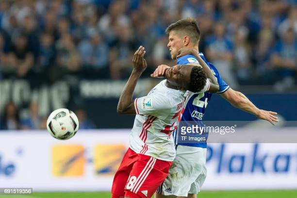 Bakery Jatta of Hamburg and KlaasJan HUNTELAAR of Schalke battle for the ball during to the Bundesliga match between FC Schalke 04 and Hamburger SV...
