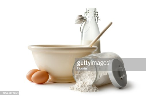 'Baking Ingredients: Bowl, Eggs, Flour and Milk'