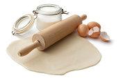 Baking Ingredients: Dough, Sugar, Rolling Pin and Eggs