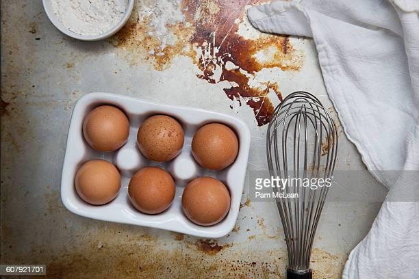 Baking Ingredients: Eggs, Flour, Whisk