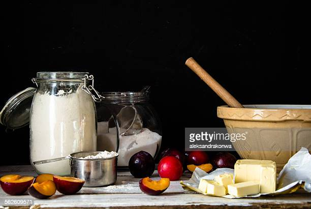 Baking ingredients for a plum cake in kitchen