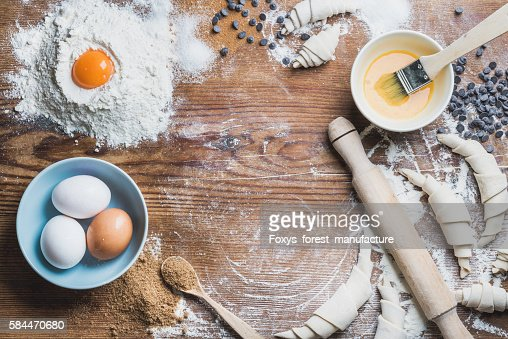 Baking ingredients for cooking croissants over wooden background, copy space : Stock Photo