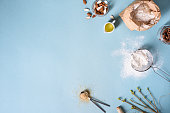 Baking ingredients for pastry on the blue background. Cooking cakes or bread concept. Top view, copy space.