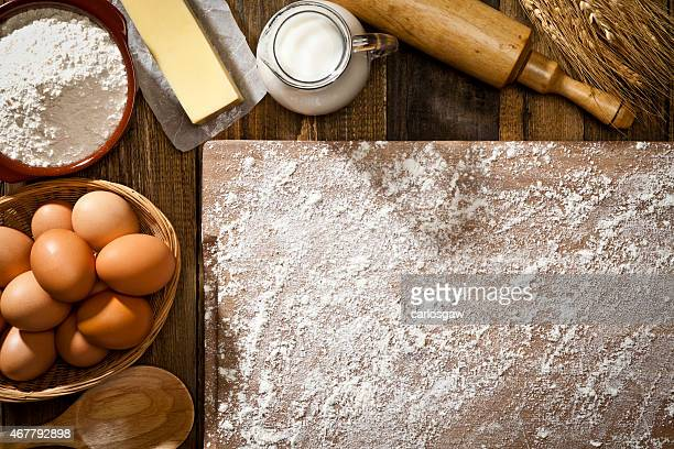 Baking ingredients in a half frame shape on wooden table