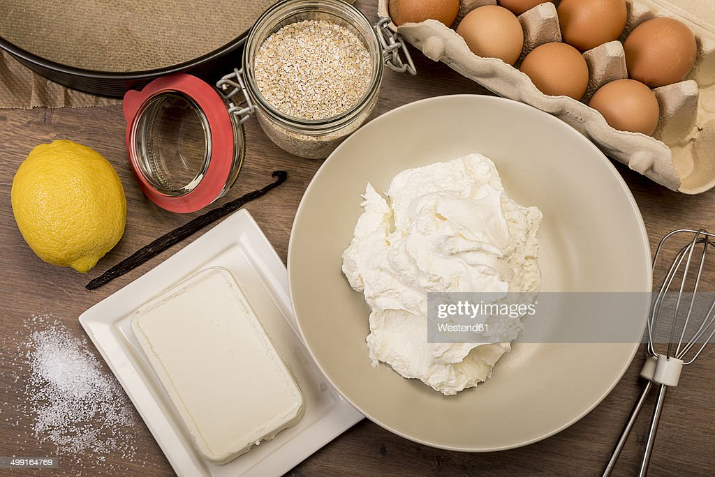 Baking ingredients of cheese cake on wooden table