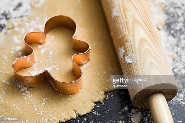 Baking Sugar Cookies with Gingerbread Man Cookie Cutter in Dough