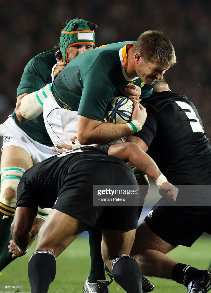 Bakkies Botha of the Springboks is hit hard during the Tri-Nations match between the New Zealand All Blacks and South Africa Springboks at Eden Park on July 10, 2010 in Auckland, New Zealand.