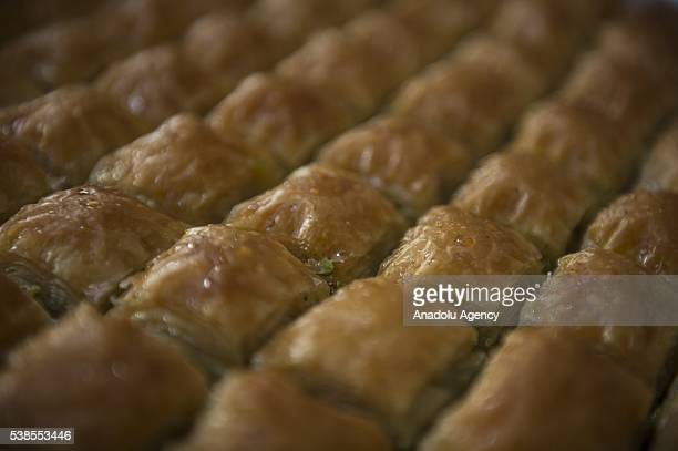 Baklavas are displayed at a Turkish bakery in Gaziantep southeast Turkey on June 7 2016 Baklava is a rich sweet pastry featured in many cuisines of...