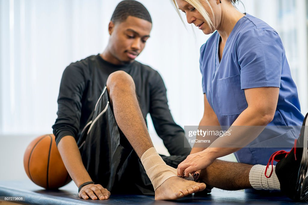 Baksetball Player Getting Bandaged Up : Stock Photo